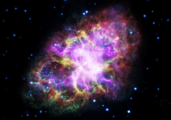 Slide 20 of 86: This composite image of the Crab Nebula, a supernova remnant, was assembled by combining data from five telescopes spanning nearly the entire breadth of the electromagnetic spectrum: the Karl G. Jansky Very Large Array, the Spitzer Space Telescope, the Hubble Space Telescope, the XMM-Newton Observatory, and the Chandra X-ray Observatory. Photo released on May 10.