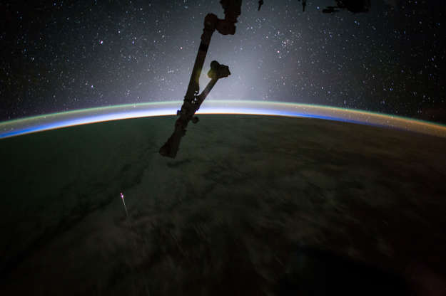 Slide 17 of 86: The SpaceX Dragon capsule reentered Earth's atmosphere before splashing down in the Pacific Ocean west of Baja California on July 3, in this photograph by NASA astronaut Jack Fischer.
