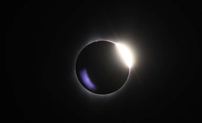 Slide 9 of 86: The diamond ring effect is visible as the moon passes in front of the sun during a total solar eclipse at Big Summit Prairie ranch in Oregon's Ochoco National Forest near the city of Mitchell on August 21, 2017.