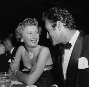 LOS ANGELES,CA - FEBRUARY 18,1952: Actress Barbara Stanwyck and Roland Gilbert attend the Golden Globe Awards in Los Angeles,CA. (Photo by Earl Leaf/Michael Ochs Archives/Getty Images)