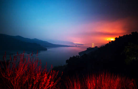 Slide 1 of 75: The Thomas Fire burns a hillside behind Lake Casitas in Ventura, California on Dec. 8.