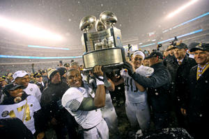 Army Black Knights quarterback Ahmad Bradshaw (17) and fullback Andy Davidson (40) hold up the Commander in Chief's trophy after beating the Navy Midshipmen 14-13 on Dec. 9 in Philadelphia, PA.