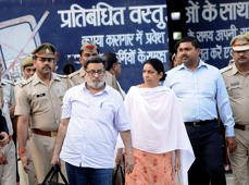 Dentist couple Nupur Talwar (C-R) and Rajesh Talwar (C-L) were released from Dasna Prison in Ghaziabad, Uttar Pradesh, after being acquitted by the Allahabad High Court in the twin murder case of their daughter Aarushi and domestic worker Hemraj Banjade. (Photo by Imtiyaz Khan /Anadolu Agency/Getty Images)