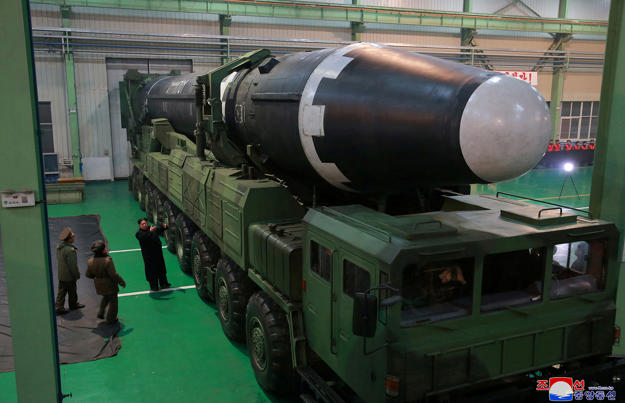 North Korea's leader Kim Jong Un is seen as the newly developed intercontinental ballistic rocket Hwasong-15's test was successfully launched.