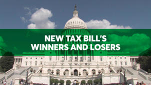 a sign in front of a building: The New Tax Bill's Winners and Losers
