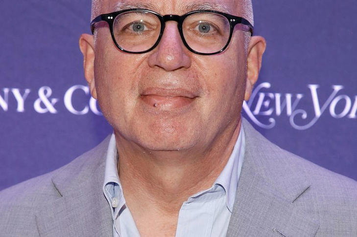 a man wearing glasses: Credits: WireImage