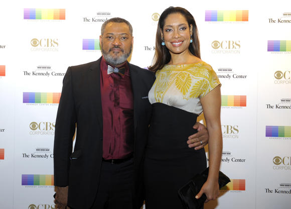 Diapositiva 42 de 50: WASHINGTON, DC - DECEMBER 6: Laurence Fishburne and his wife, Gina Torres walk the red carpet before the Kennedy Center Honors December 06, 2015 in Washington, DC. The honorees include George Lucas, Carole King, Cicely Tyson, Rita Moreno and Seiji Osawa. (Photo by Katherine Frey/The Washington Post via Getty Images)