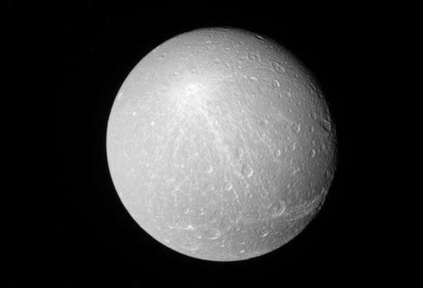 Slide 24 of 86: A view of Saturn's moon Dione released by NASA on February 21, 2017, looking toward the Saturn-facing side of Dione. The image was taken with the Cassini spacecraft narrow-angle camera on Nov. 26, 2016 using a spectral filter which preferentially admits wavelengths of near-infrared light centered at 727 nanometer