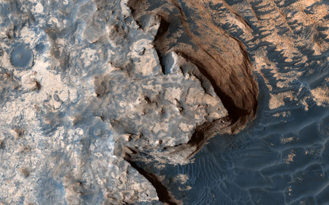 Slide 21 of 86: An image acquired by the High Resolution Imaging Science Experiment (HiRISE) camera aboard NASA's Mars Reconnaissance Orbiter on April 18, 2017, shows a rugged cliff edge. Image released June 22, 2017. NASA/JPL/University of Arizona/Handout via REUTERS