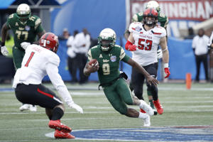 Quinton Flowers #9 of the South Florida Bulls runs the ball against the Texas Tech Red Raiders in the second half of the Birmingham Bowl at Legion  domain on December 23, 2017 in Birmingham, Alabama. South Florida won 38-34.