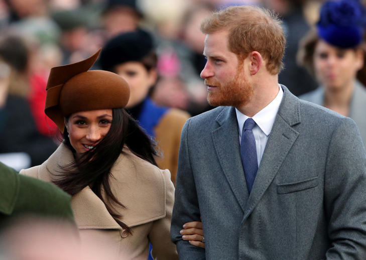 Britain's Prince Harry and his fiancee Meghan Markle arrive at St Mary Magdalene's church for the Royal Family's Christmas Day service on the Sandringham estate in eastern England