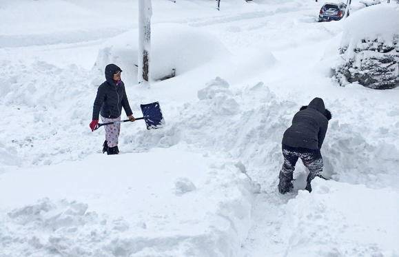 Slide 1 of 42: People dig out the path by their house after the record snowfall in Erie, U.S., December 26, 2017 in this picture obtained from social media.
