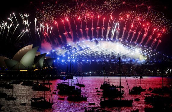 Slide 1 de 49: SYDNEY, AUSTRALIA - JANUARY 01:  Fireworks explode off the Harbour Bridge and Opera House to bring in the New Year on New Year's Eve on January 1, 2018 in Sydney, Australia.  (Photo by James D. Morgan/Getty Images)