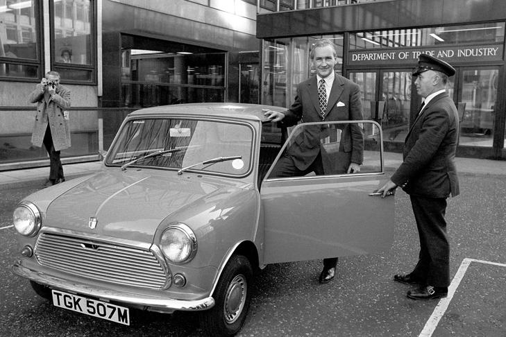 Tom Boardman, Minister for Industry, sets an example in fuel economy when he chooses a Mini over an Austin 1800 or Rover 3500