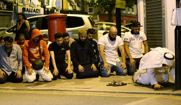 File photo dated 19/06/17 of local people observing prayers at Finsbury Park in north London.