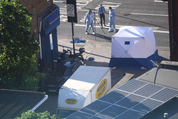 File photo dated 19/06/17 of a forensic tent next to a van in Finsbury Park, north London.