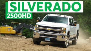 a truck is parked in front of a sign: 2016 Chevrolet Silverado 2500HD Quick Drive