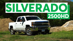 a car parked in front of a sign: 2016 Chevrolet Silverado 2500HD Road Test