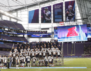 The New England Patriots assemble for their team photo in U.S. Bank Stadium Saturday, Feb. 3, 2018, in Minneapolis. The Patriots are scheduled to face the Philadelphia Eagles in the NFL Super Bowl 52 football game Sunday.