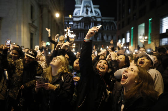 Slide 1 of 63: Fans celebrate in Center City after the Philadelphia Eagles defeated the New England Patriots to win the Super Bowl on February 4, 2018 in Philadelphia, Pennsylvania.