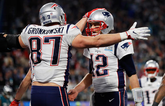 Slide 4 of 12: MINNEAPOLIS, MN - FEBRUARY 04: Rob Gronkowski #87 and Tom Brady #12 of the New England Patriots celebrate their 4-yard touchdown pass during the fourth quarter against the Philadelphia Eagles  in Super Bowl LII at U.S. Bank Stadium on February 4, 2018 in Minneapolis, Minnesota.