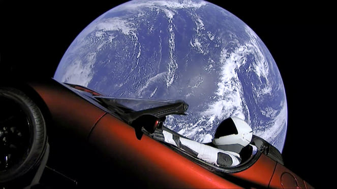 Slide 2 of 14: This image from video provided by SpaceX shows the company's spacesuit in Elon Musk's red Tesla sports car which was launched into space during the first test flight of the Falcon Heavy rocket on Tuesday, Feb. 6, 2018. (SpaceX via AP)