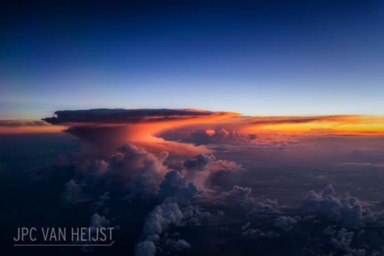 Slide 29 of 31: Thunderstorms illuminated by the setting sun over Texas