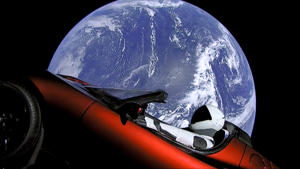 CAPTION: This image from video provided by SpaceX shows the company's spacesuit in Elon Musk's red Tesla sports car which was launched into space during the first test flight of the Falcon Heavy rocket on Tuesday, Feb. 6, 2018. (SpaceX via AP)