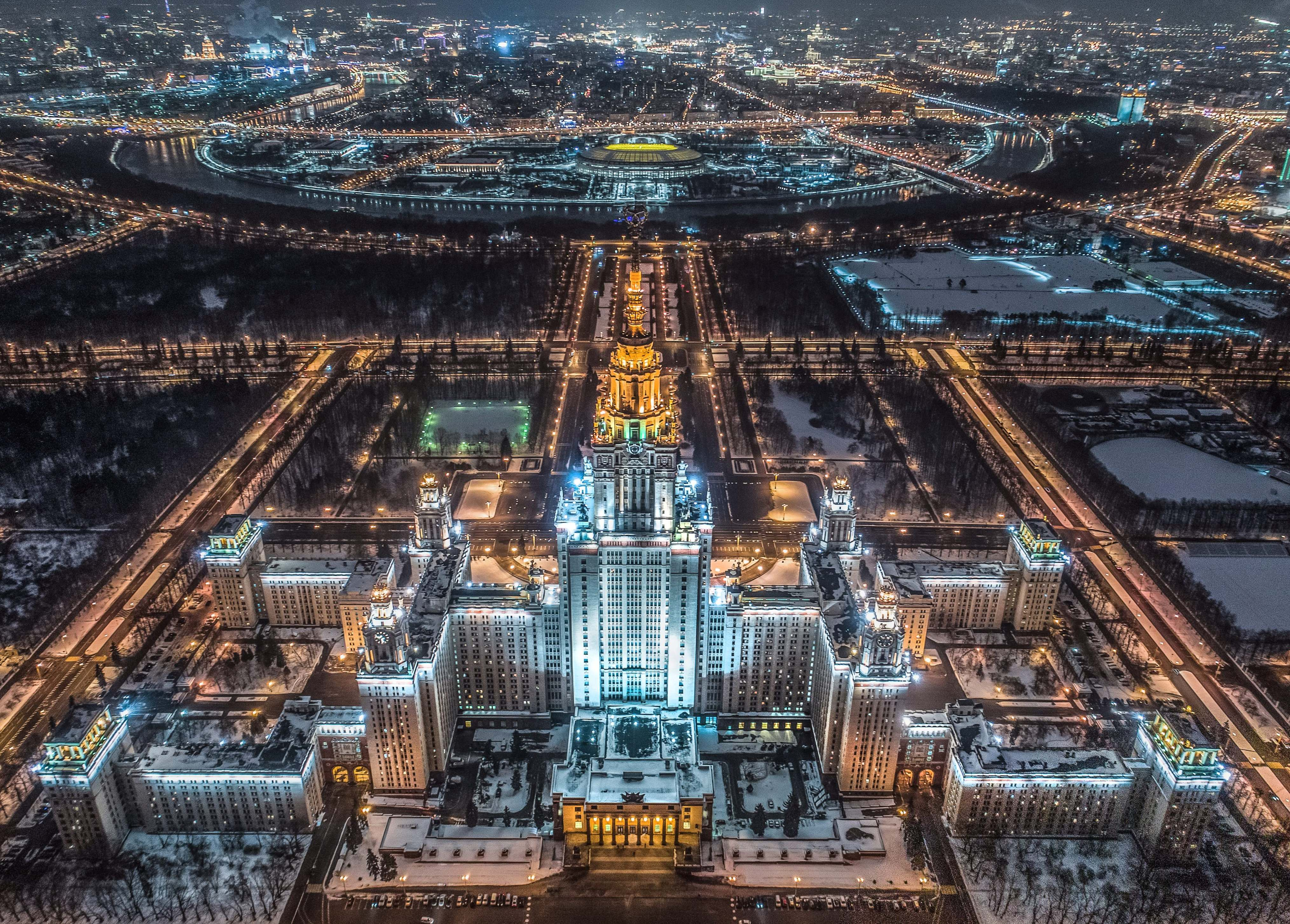 Slide 49 of 73: CAPTION: An aerial view taken with a drone in Moscow on January 27, 2018 shows the main building of the Moscow State University, Luzhniki Stadium and the Moskva River. / AFP PHOTO / Dmitry SEREBRYAKOV (Photo credit should read DMITRY SEREBRYAKOV/AFP/Getty Images)