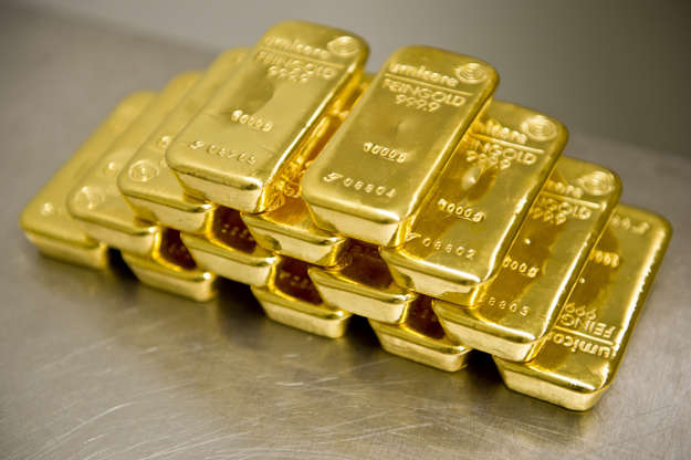 Slide 2 of 12: Gold bars in the safe of Pro Aurum Gold trading house on February 16, 2016 in Muenchen, Germany. (Photo by Michael Gottschalk/Photothek via Getty Images)