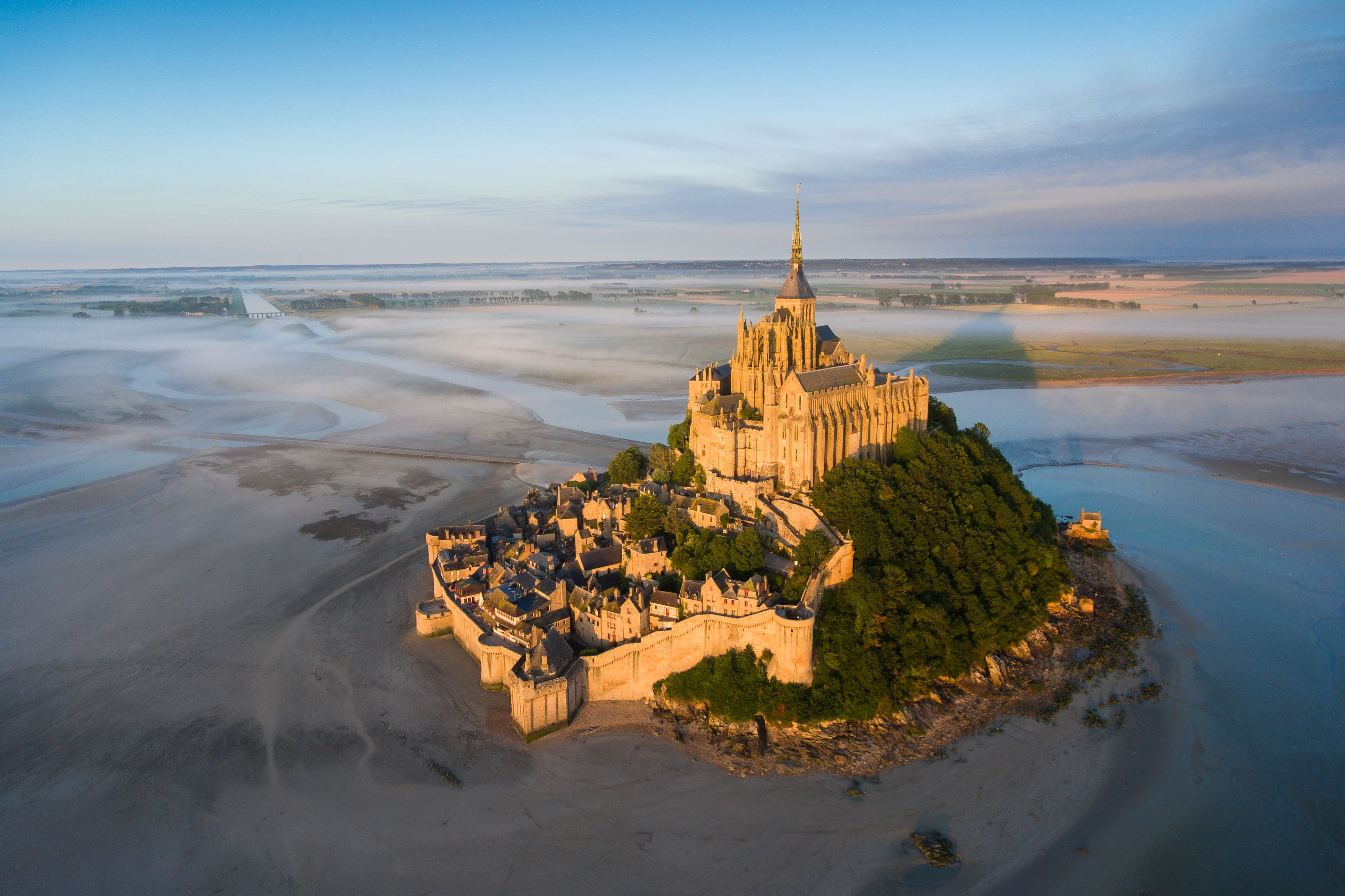 Slide 14 of 73: Aerial view of Mont Saint-Michel taken by drone, Normandy, France - Jul 2017