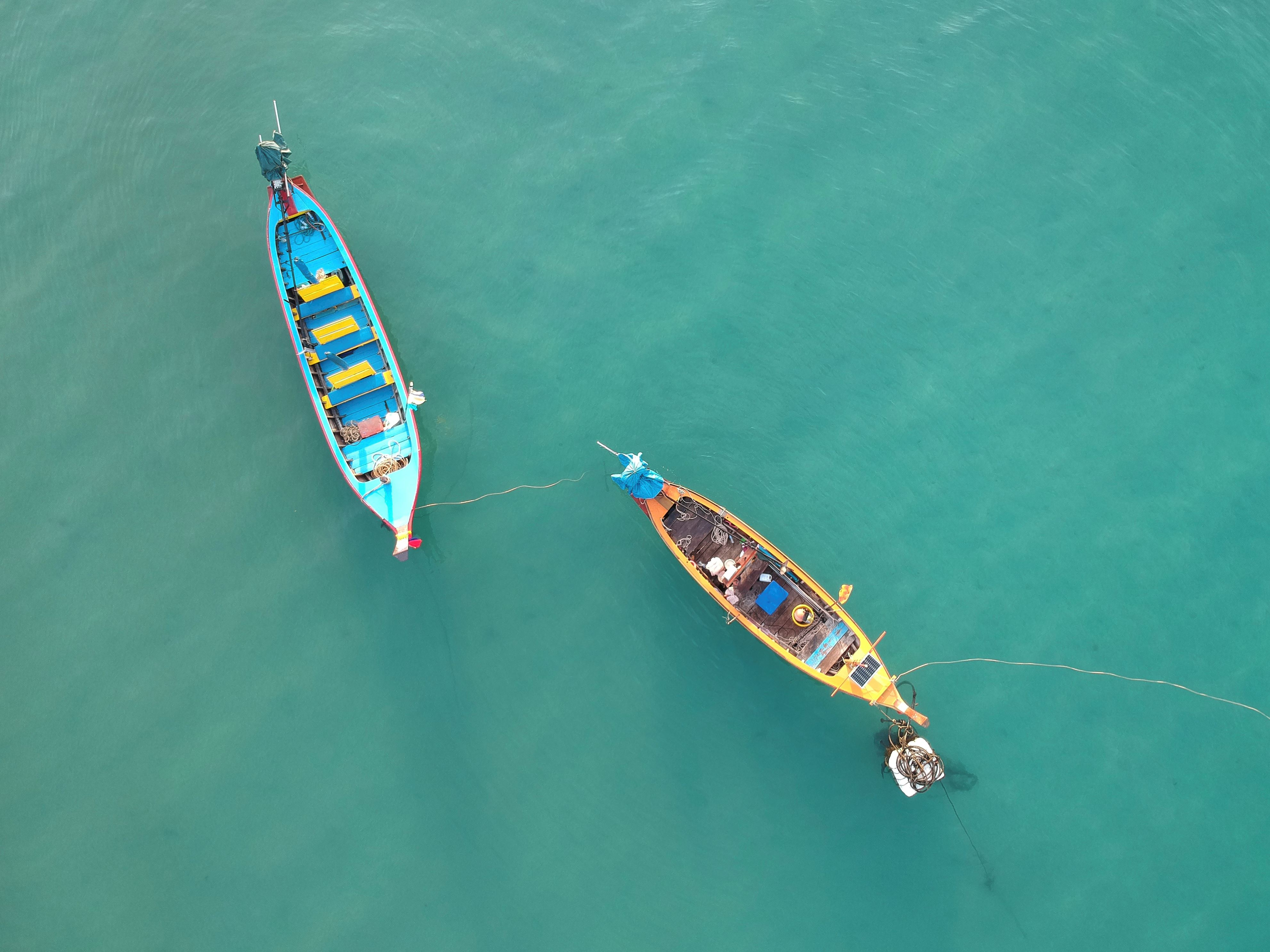 Slide 7 of 73: CAPTION: KATA BEACH, PHUKET, THAILAND - 2017/11/20: Aerial view of two longtail boats in the Andaman Sea. The small watercraft are commonly seen all over Thailand, particularly the seaside locations in the southern parts of the country. Editors Note: A drone was used for this picture. (Photo by Craig Ferguson/LightRocket via Getty Images)