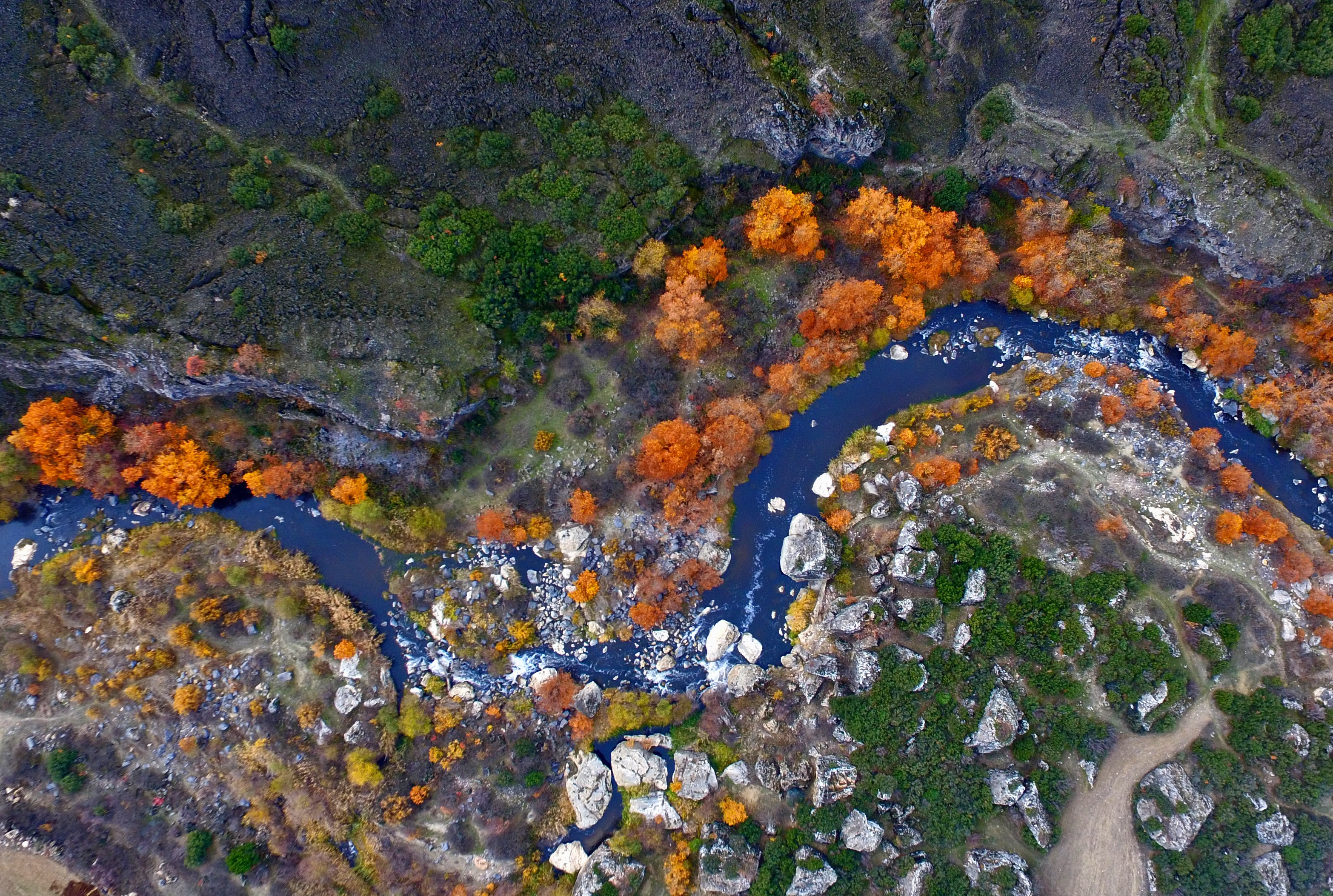 Slide 53 of 73: MANISA, TURKEY - NOVEMBER 21: A drone photo shows an aerial view of trees during the autumn season at Kula Volcanic Geopark located in Turkey's Manisa on November 21, 2017.
