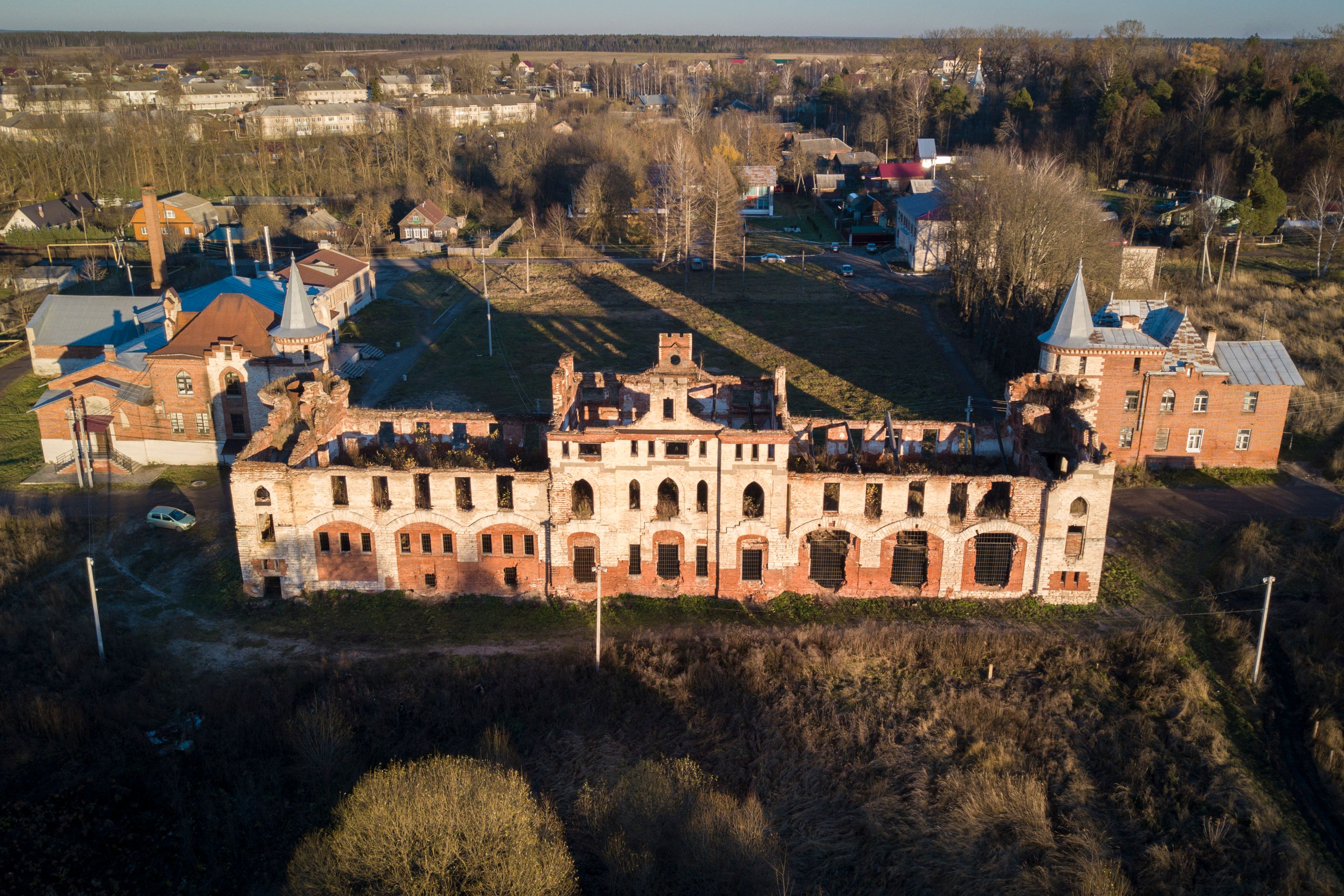 Slide 63 of 73: An aerial view taken with a drone on November 8, 2017 shows the stables at the neglected Khrapovitsky Estate in Muromtsevo, Vladimir region. / AFP PHOTO / Andrei BORODULIN / TO GO WITH AFP STORY 'Russia's pre-Revolutionary estates crumble in neglect' by Maria ANTONOVA