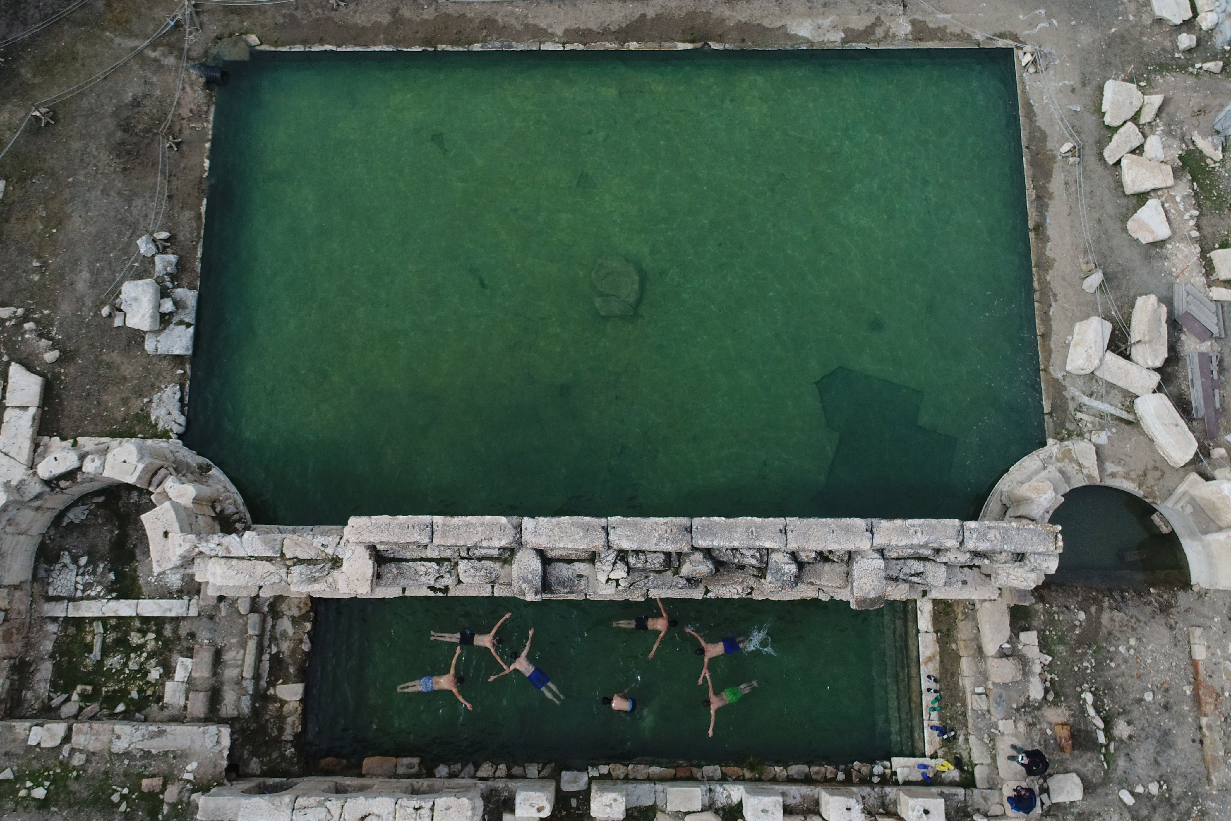 Slide 58 of 73: YOZGAT, TURKEY - FEBRUARY 08: A drone photo shows the aerial view of 2,000-year old ancient Roman Bath Basilica Therma at Sarikaya district of the central Yozgat province in Turkey on February 08, 2018. With it's 48-49 centigrade degrees water temperature the bath provides an opportunity for swimming during winter season. Basilica Therma, also known as the King's Daughter which is one of the historical figure of the Roman Empire, attracts many tourists' attention