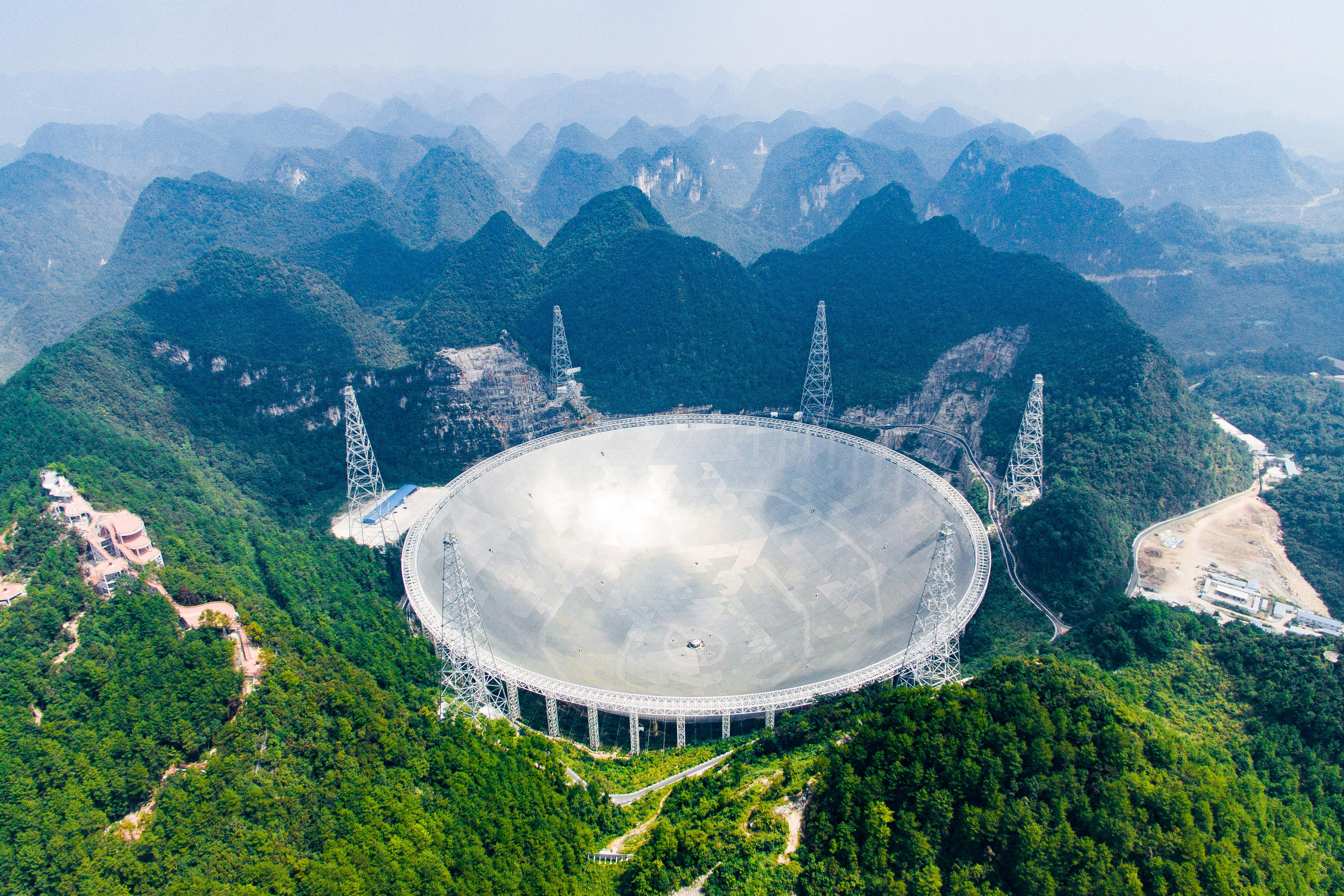 Slide 61 of 73: CAPTION: BEIJING, Dec. 13, 2016 -- Photo taken on Sept. 24, 2016 shows the 500-meter Aperture Spherical Telescope in Pingtang County, southwest China's Guizhou Province. The FAST, world's largest radio telescope, measuring 500 meters in diameter, was completed and put into use. Drones have been in common use in photojournalism in 2016. (Xinhua/Liu Xu via Getty Images)