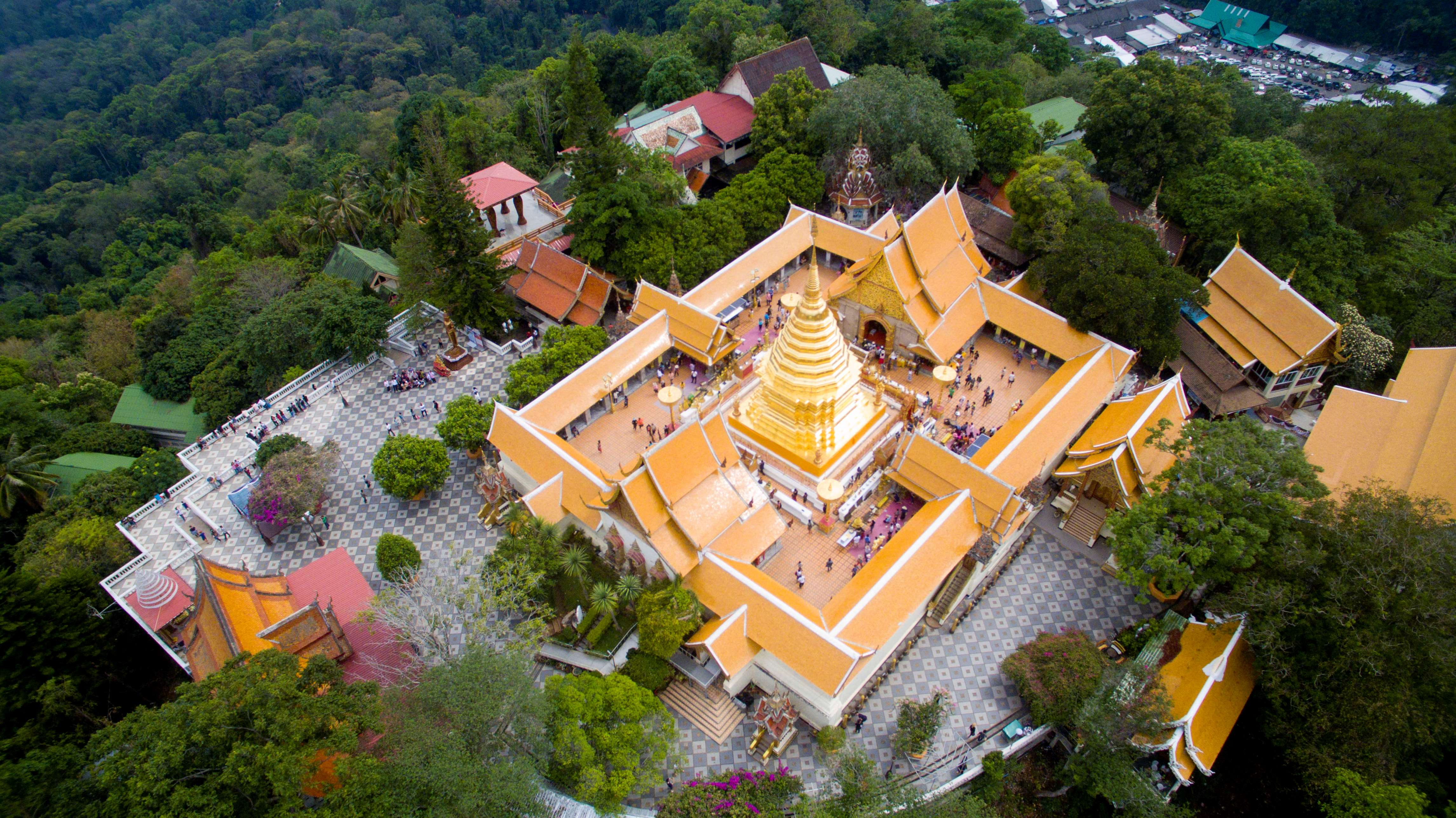 Slide 16 of 73: CHIANG MAI, CHIANG MAI DISTRICT, THAILAND - 2017/04/15: (EDITORS NOTE: Image has been created using a drone.) Aerial drone view over Wat That Doi Suthep in Chiang Mai. It is a buddhist temple located on a hill overlooking the city.