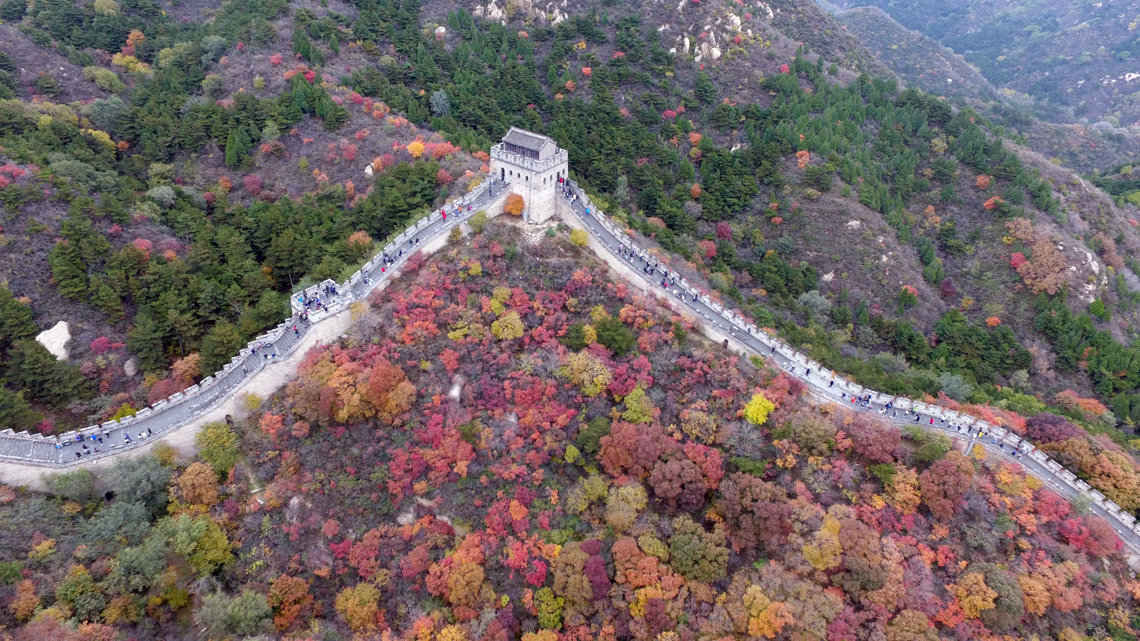 Slide 68 of 73: ourists visit the Badaling Great Wall in Beijing, capital of China, Oct. 23, 2016. Drones have been in common use in photojournalism in 2016. (Xinhua/Chen Yehua via Getty Images)