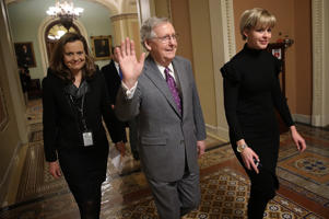 Senate Majority Leader Mitch McConnell is shown after the passage of the long-term funding bill on Friday in Washington.