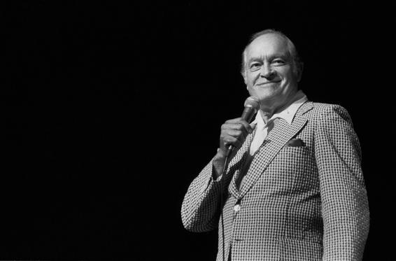 "Slide 1 of 49: Milton Berle, in drag, performs a skit with Bob Hope during taping of the ""Bob Hope Buys NBC"" special at NBC Studios in Burbank, Calif., Sept. 8, 1985. This is Berle's first network performance since his quadruple bypass heart surgery last June. (AP Photo/Shin)"