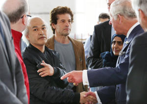File photo dated 27/06/17 of the Prince of Wales meeting local residents, including Anh Nhu Nguyen (second left, dark shirt), during a visit to the Westway Sports Centre in the aftermath of the Grenfell Tower disaster in west London