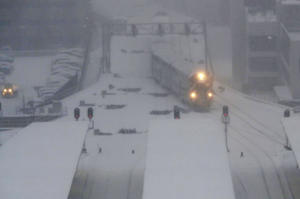 A commuter train pulls into the LaSalle Street station under a heavy snow fall early Friday, Feb. 9, 2018, in Chicago. The National Weather Service issued winter-weather warnings and advisories across the upper Midwest. The snow that began falling late Thursday afternoon was expected to continue through Friday as the storm moves east.