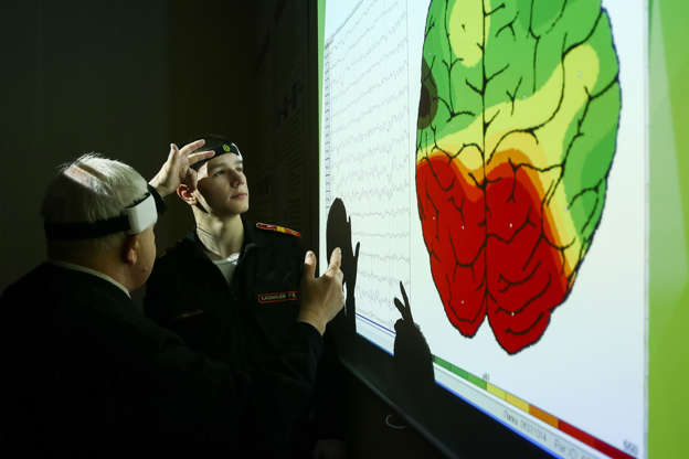 A cadet of the Tula Suvorov Military School look at an EEG recording