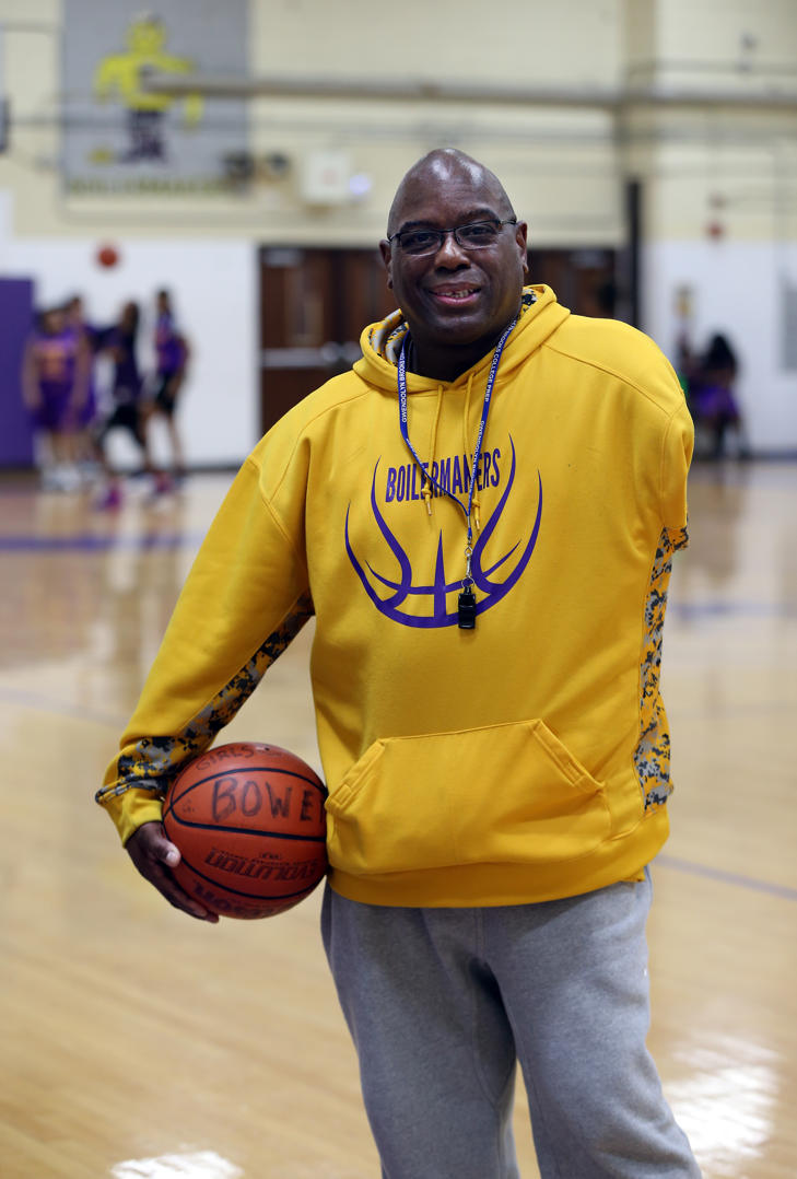 <p>Kennard Johnson, the girls basketball coach at Bowen High School in Chicago, conducts a practice on January 24, 2018. In 1978, Johnson was shot by a man wielding a shotgun and his left arm eventually had to be amputated.</p>