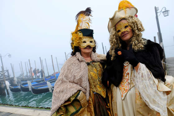 Slide 1 of 15: CAPTION: Masked revellers pose during the Carnival in Venice, Italy January 28, 2018. REUTERS/Manuel Silvestri