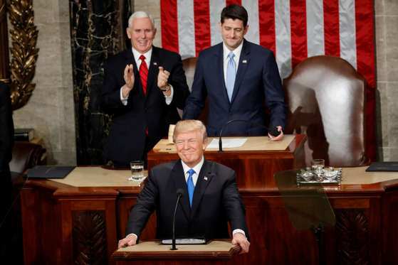 Slide 1 of 31: President Donald Trump steps to the podium to begin his State of the Union address to a joint session of Congress on Capitol Hill in Washington, Tuesday, Jan. 30, 2018. Behind President Trump are Vice President Mike Pence and House Speaker Paul Ryan of Wisconsin. (AP Photo/Pablo Martinez Monsivais)