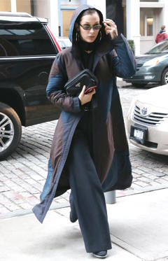 Slide 4 de 61: miss – Perhaps the outfit under the coat is more inspiring but the coat is doing nothing for me. Paired with the loose-fitting trousers, there is no shape to this outfit and the dark colours make the whole thing dull.
