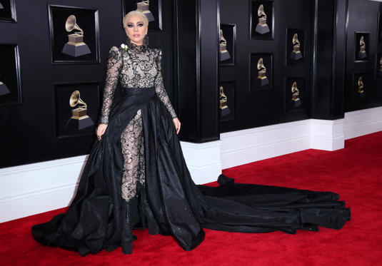 Slide 5 de 61: hit – This is a very dramatic outfit and Lady Gaga looks fierce! I love the detailing and the long train. I think it was a great idea to put her hair up to let the dress do all the talking. Finally, I have to give her credit for being able to walk in those shoes!