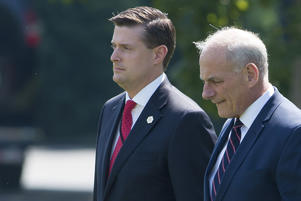 White House Chief of Staff John Kelly (R) and White House Staff Secretary Rob Porter (L)walk to Marine One prior to departure from the South Lawn of the White House in Washington, DC, August 4, 2017.