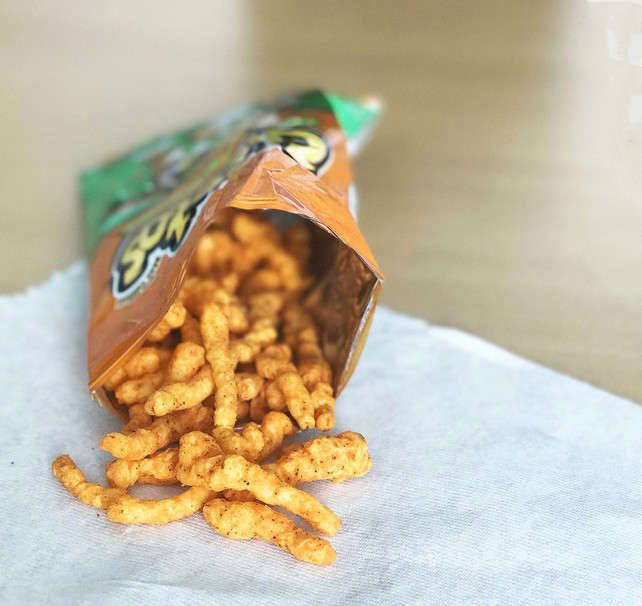a close up of food: reduce cravings for junk food Cheetos snacks